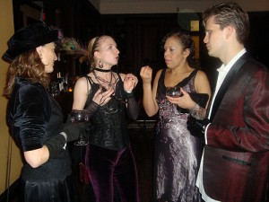Hope, Leanna, EKM and Jason talk costumes, apparently serious business.