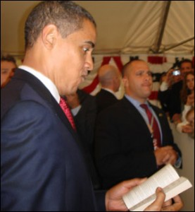The President thumbing through yes, a romance novel.